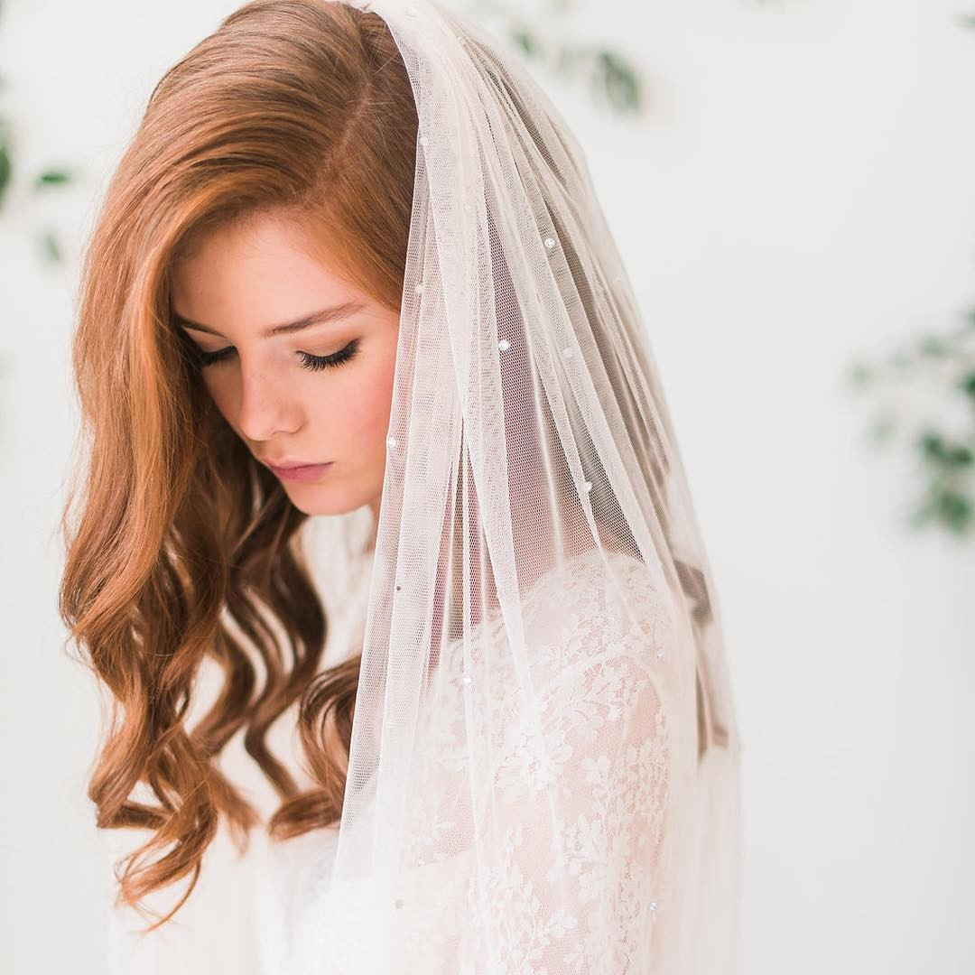 Our bridal veil collection features beautiful handmade veils featuring an array of lengths, colors and styles. Custom options are available