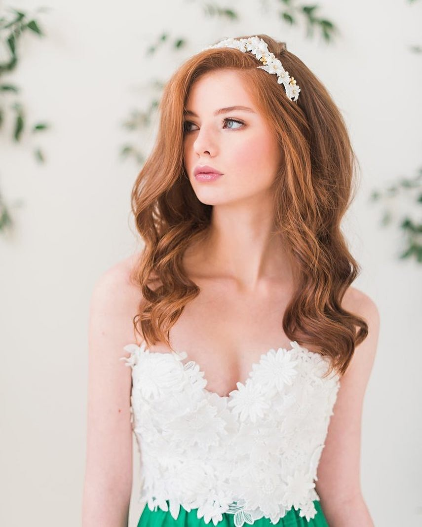 Our floral headband (style 3102) features silk flowers, rhinestones, brass findings, acrylic leaves and a thin gold headband. Photo