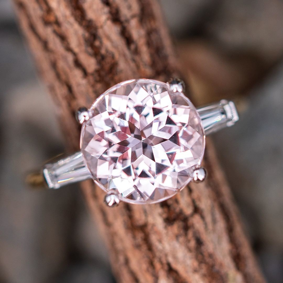A beautiful morganite with diamond accents. Platinum top, yellow gold band.
