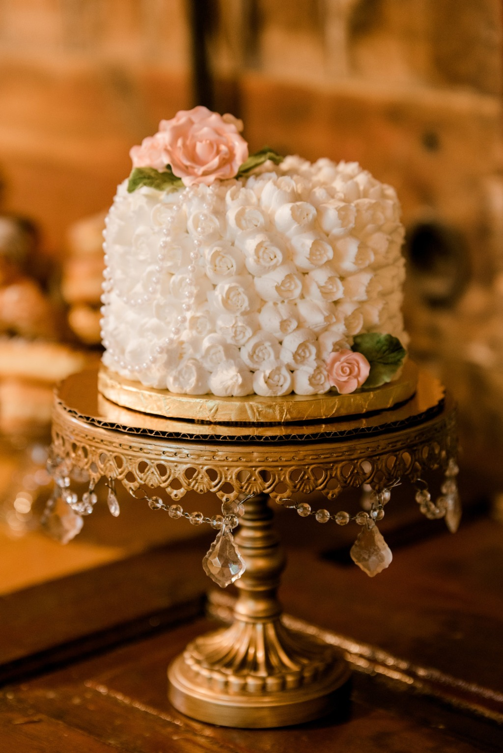 Pretty rosette wedding cake with pearls! Cake Designer: Grandma's Bakery // Antique Gold Chandelier Cake Stand: Opulent Treasures