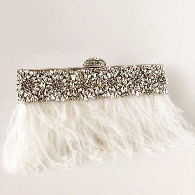 The ultimate in Sparkle!! Designed with gorgeous off white ostrich feathers.