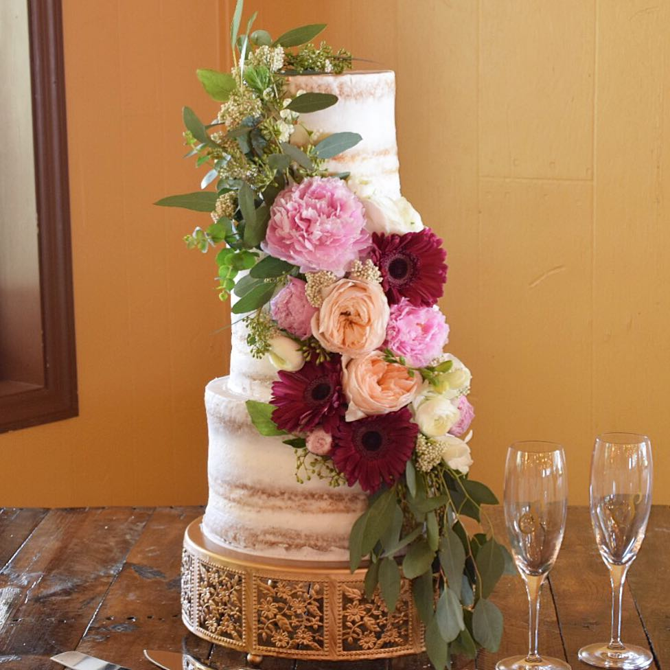 Real flowers add a touch of elegance and romance to your wedding cake. Antique Gold Cake Stand by Opulent Treasures. Semi-naked wedding
