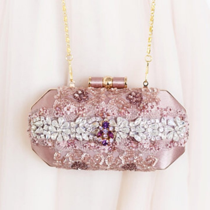 Yes Please!! A gorgeous touch of pink and rhinestone are perfect for that bride who loves a touch of color.