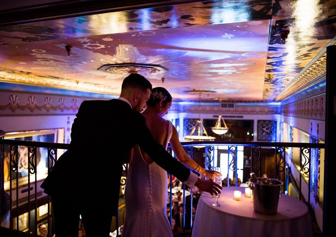 Elegant settings for an elegant couple. Raise a glass and do a toast, from the mezzanine, to the guests below!