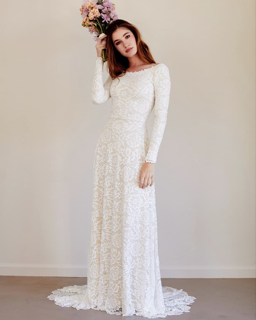 This soft and luxurious lace gown features a sleek silhouette that epitomizes timeless beauty and effortless grace. Our favorite lace