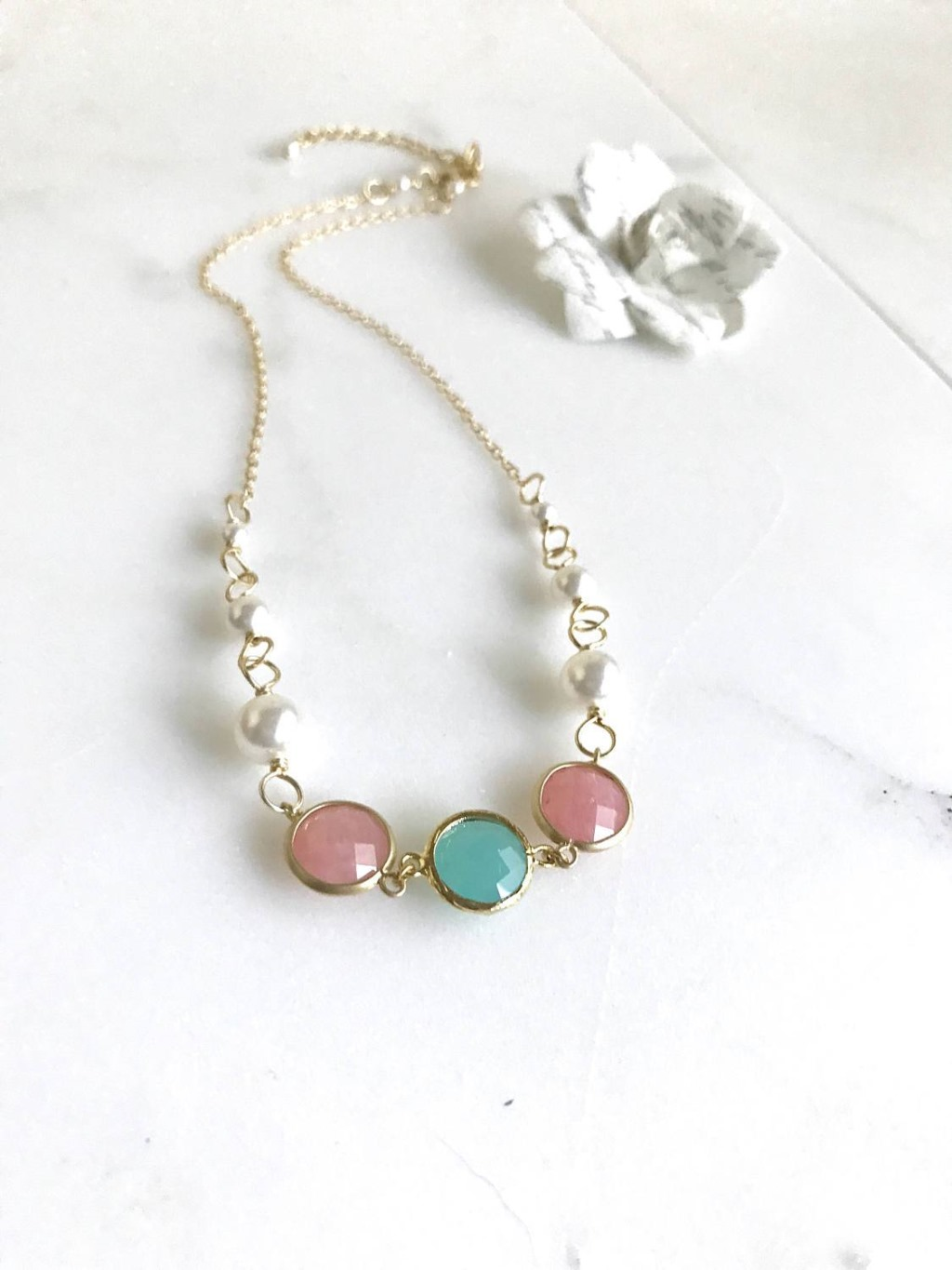 This necklace is very elegant and yet also has a pop of color with the framed stones in coral pink and turquoise. Elegant and yet very