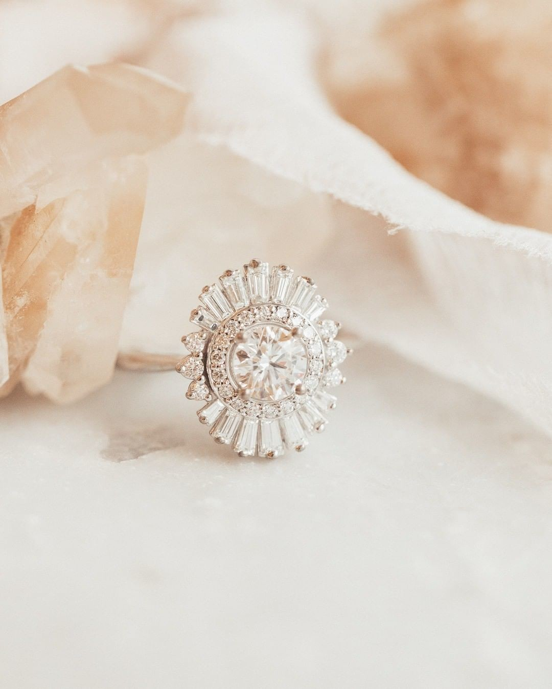 Swooning over our brand new baguette halo ring with a round diamond in 14k white gold! Check her out today at our Tennyson location
