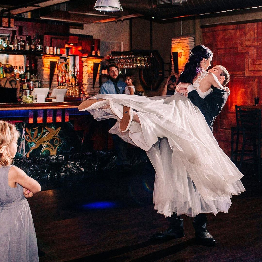 We just love when a bride is literally swept off of her feet!