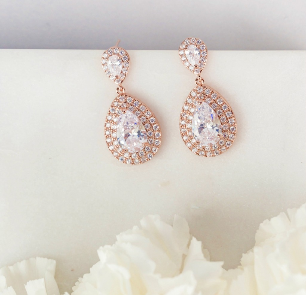 These teardrop earrings are the perfect accessory for your wedding day. Find these and more at Wink of Pink Shop!