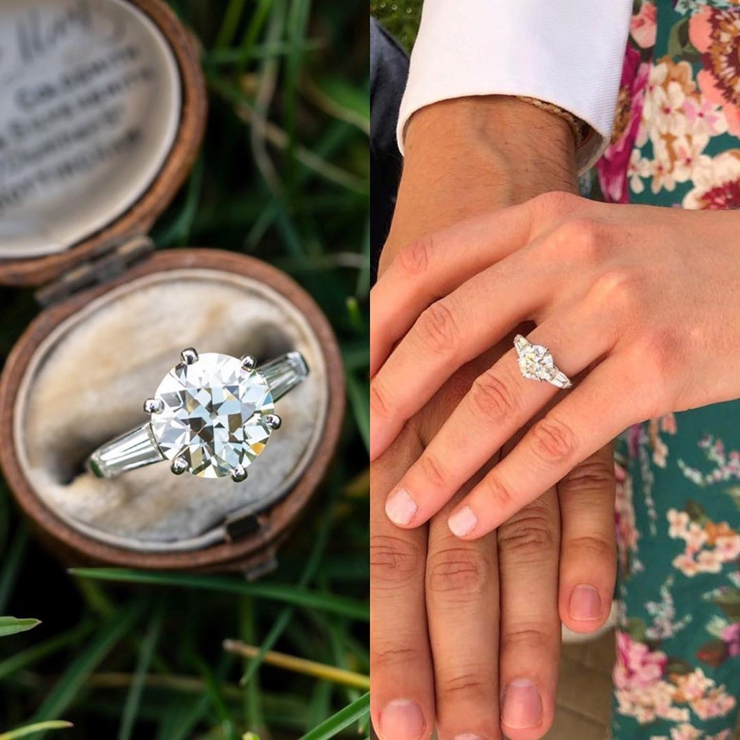 Princess Beatrice's engagement ring is definitely a stunner. A large round diamond held with six prongs and tapered baguette side