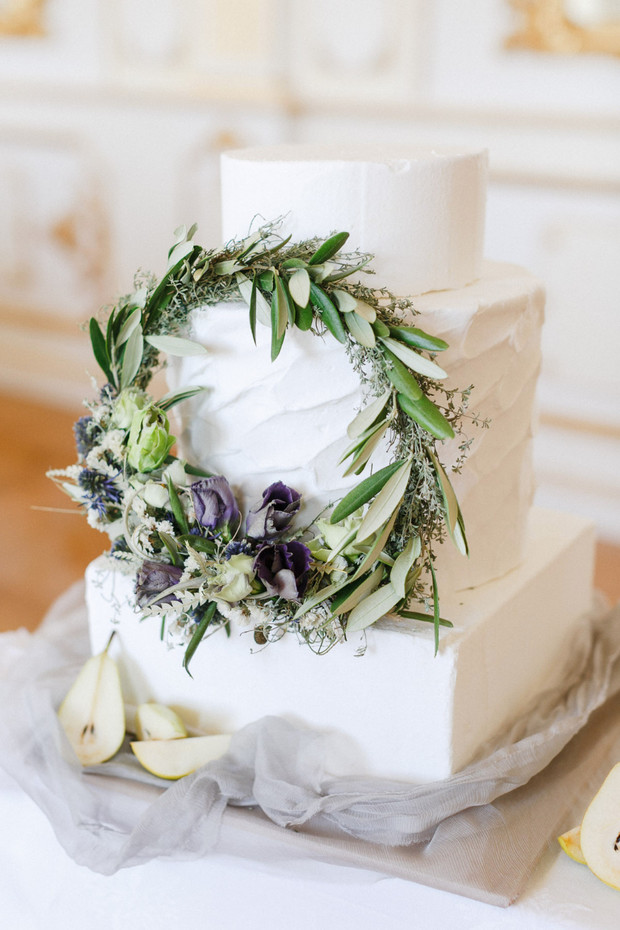 white wedding cake with wreath