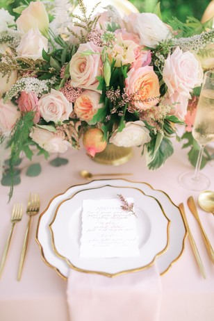 elegant pink and gold wedding table setting