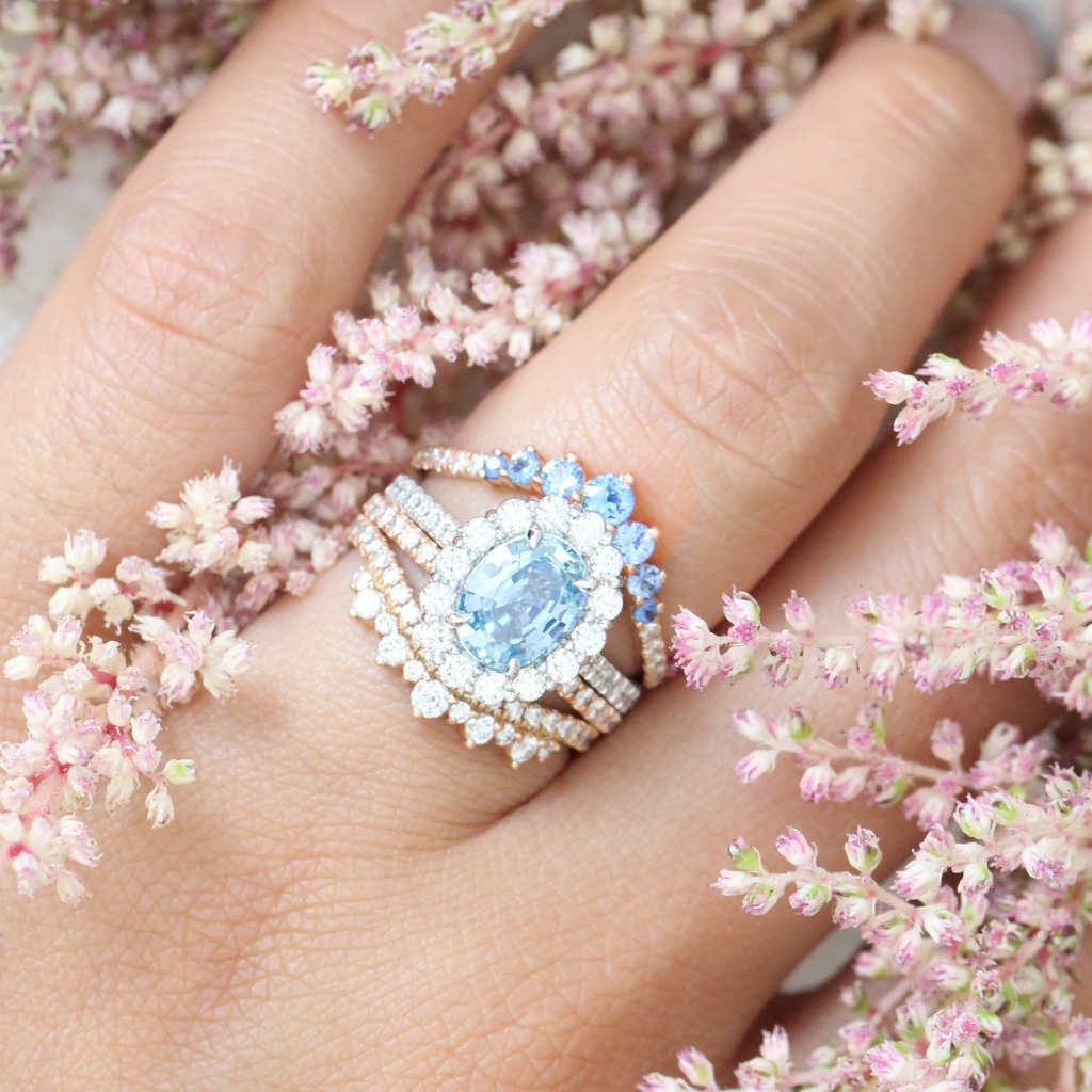 Mix and match your bridal set with different metals, like this 14k white gold One Of A Kind Natural Aqua Blue Sapphire halo ring featuring