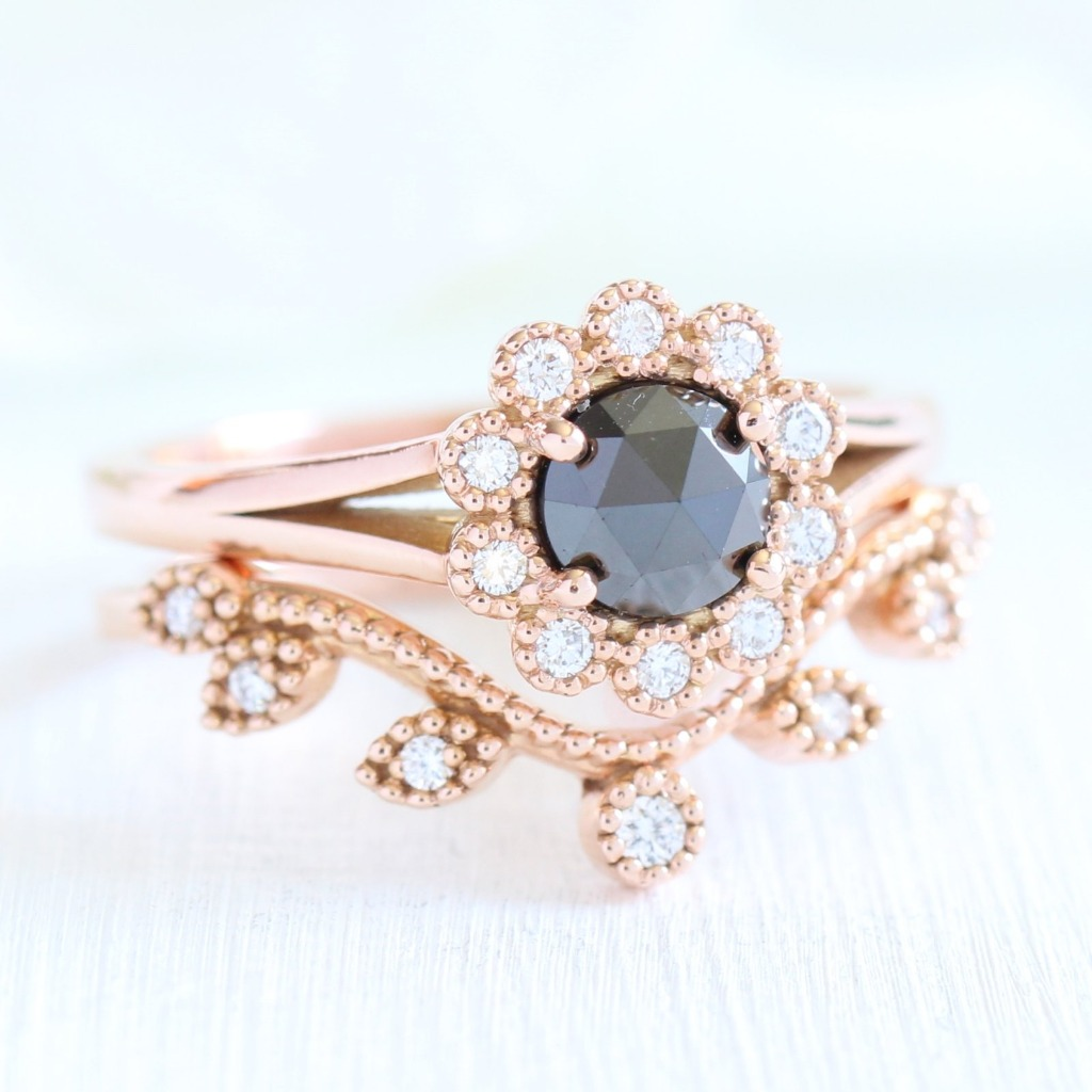 Unique and elegant! This vintage inspired rose cut diamond bridal set in split shank features a rose cut black diamond engagement ring