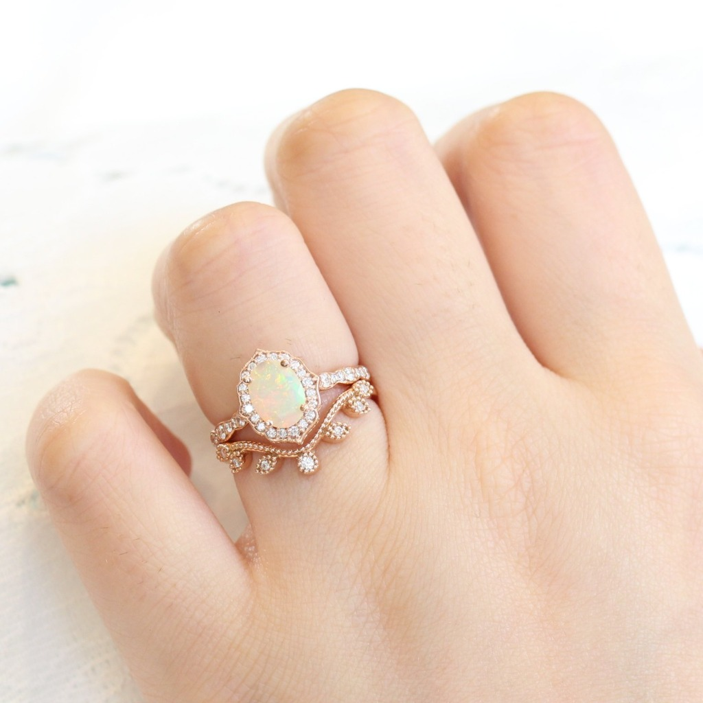 Stunning unique and vintage inspired opal bridal set showcases an opal engagement ring in 14k rose gold vintage floral diamond ring
