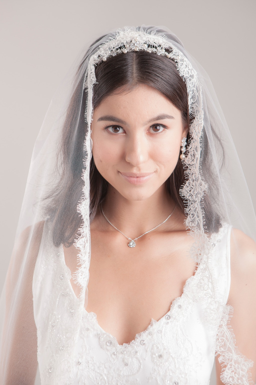 Hayley is a beautiful wedding veil with romantic wild rose and leaf border of lightly corded French lace. Check out more details from