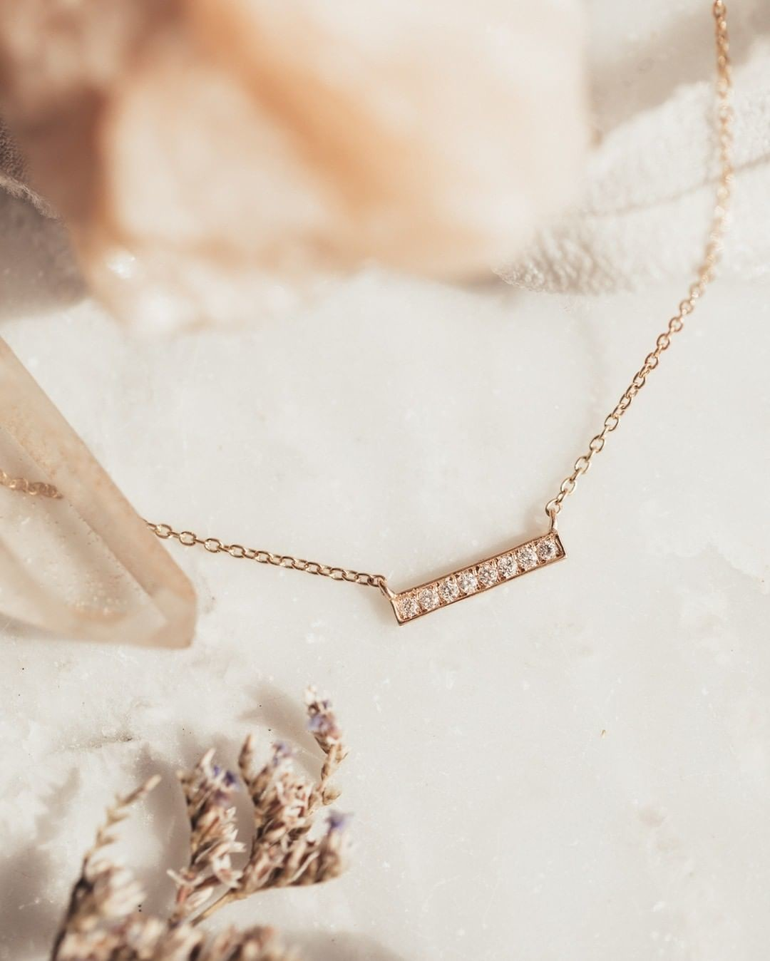 Raise the bar with our dainty rose gold & diamond necklace.