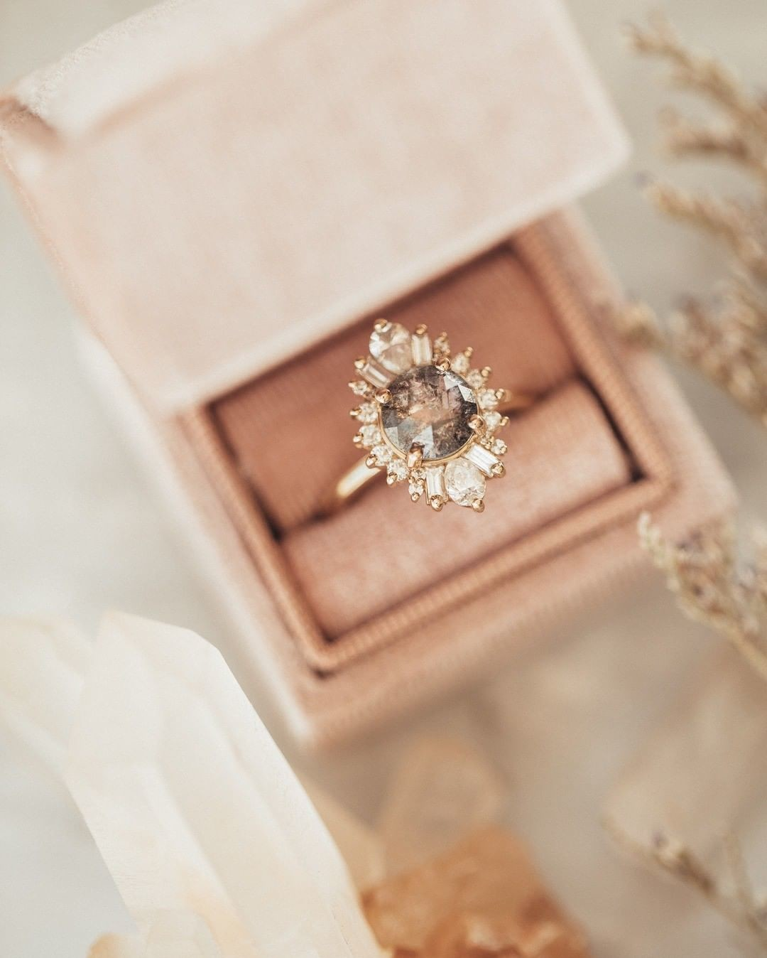 Simply stunning salt & pepper diamond ring with a baguette and pear diamond halo sitting pretty in our velvet blush