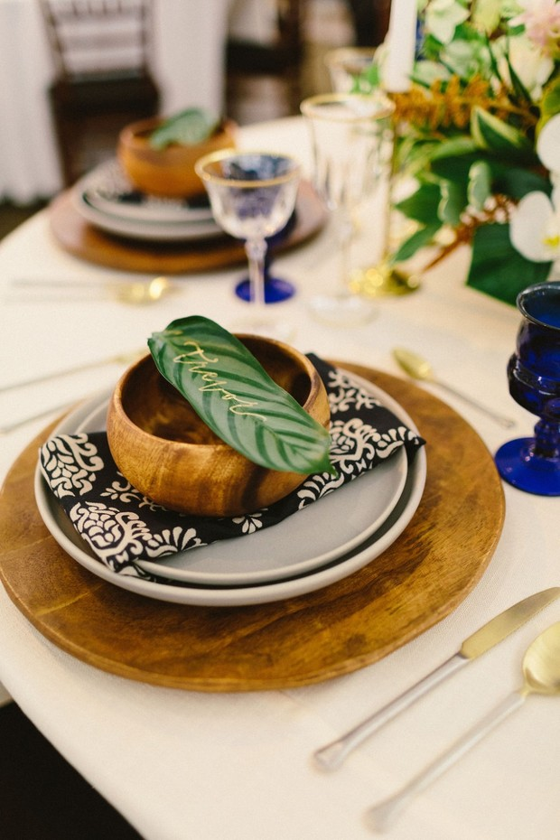 wood and bold patterned wedding place setting