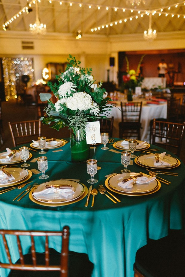 emerald green and gold wedding table decor