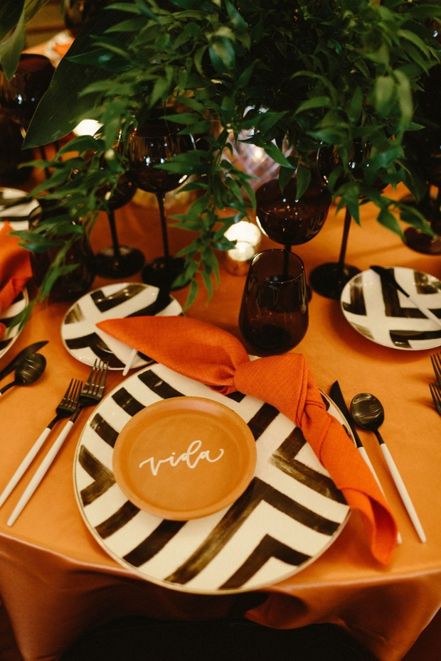 bold black and white and terracotta wedding place setting
