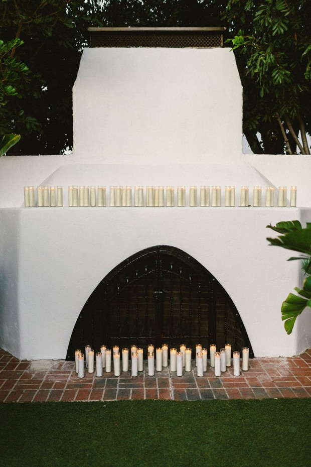 candle lit fireplace ceremony backdrop