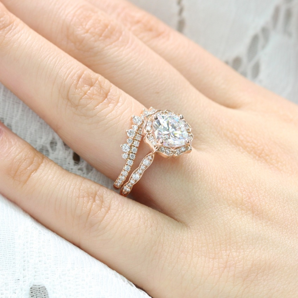 Intricate yet unique creation! This Moissanite bridal set features a 8x8mm cushion cut forever one moissanite engagement ring set in