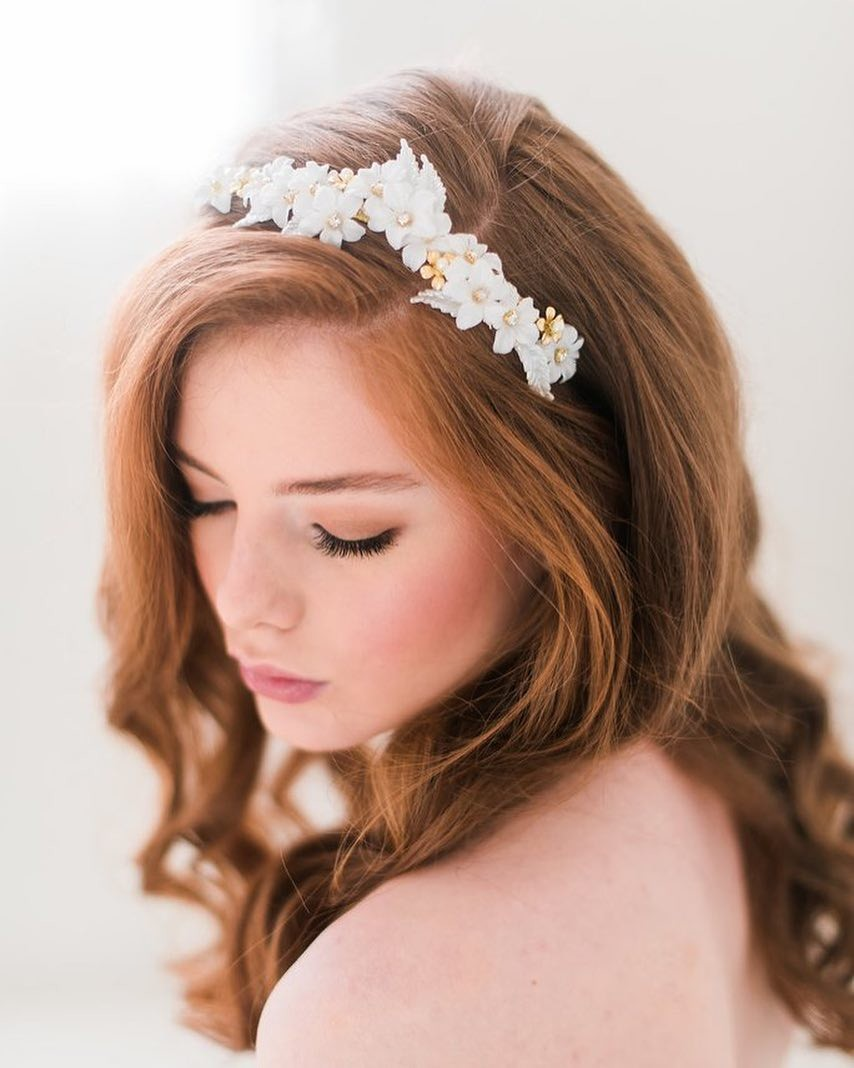 Our gold and white floral headband (style 3102) features cotton flowers, rhinestones, brass findings, acrylic leaves and is attached