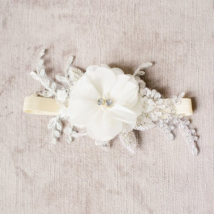 Our chiffon flower garter (style 2019) features soft hand cut chiffon, crystals, rhinestones, pearls, millinery accents, metallic lace