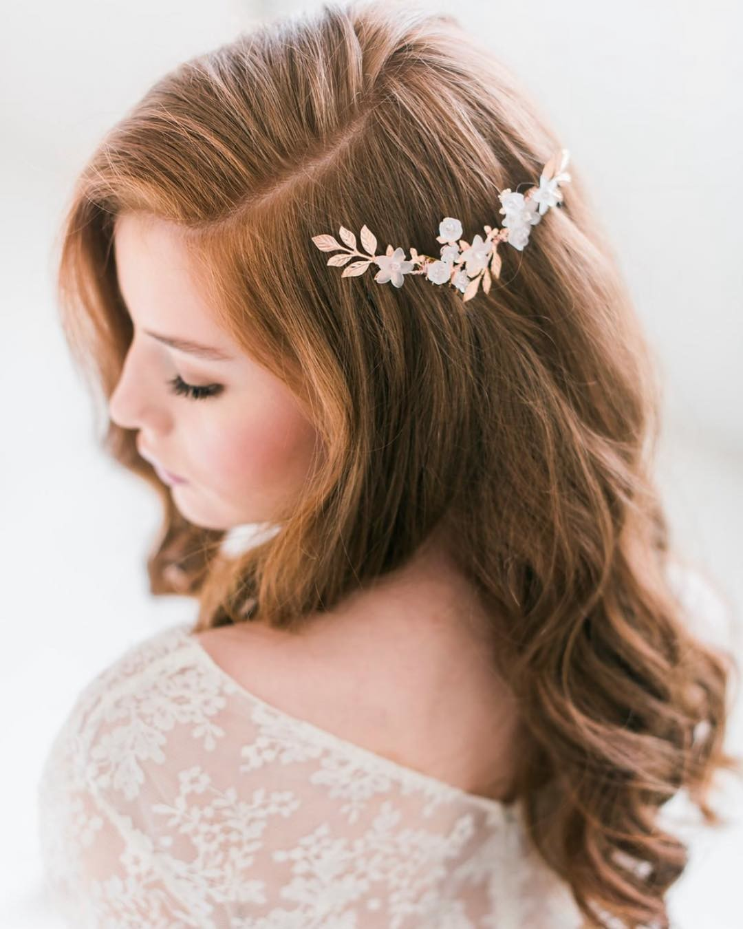 Our rose gold floral hair comb features hand wired floral elements, crystals and rose gold accents. All handmade in the USA. Photo