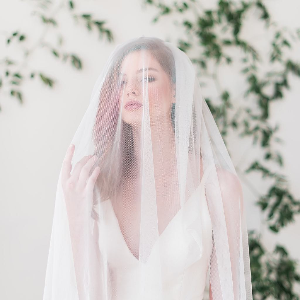 Our best selling bridal veil features soft English net and an attached blusher. Available in multiple lengths and colors. Photo by