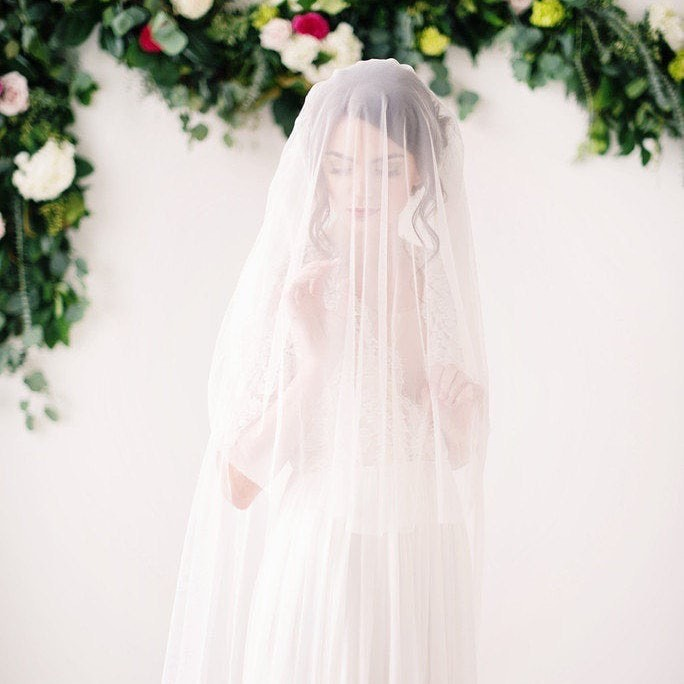 Our beautiful English net veil will have you swooning. Available in multiple colors and lengths. This beauty can be worn forward or