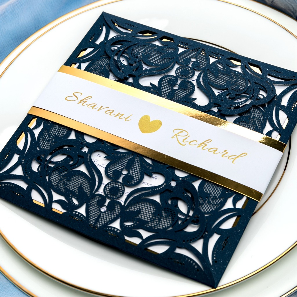 This navy blue square invite are personalized with gold foil belt with your and groom's names. We love the royal and classic hue