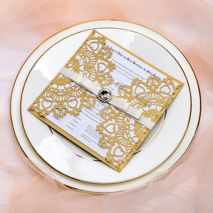This laser cut invite features luxurious floral laser cutting and big chic diamante. Perfect for any season!