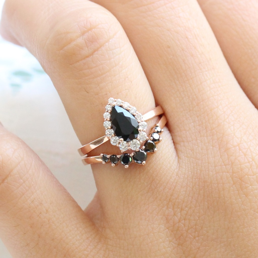 One of our most popular Tiara Halo Collection features many center stones, like this Pear Black Spinel Engagement Ring. This is our