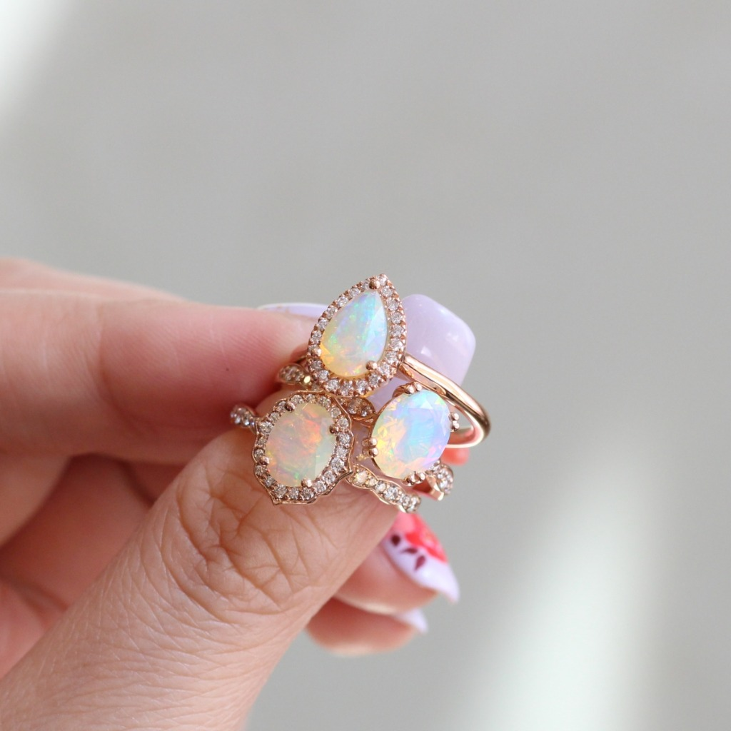 We can't just pick one since all of them look so breathtaking! Here are some of our Opal Engagement Rings in Solitaire, Halo, and