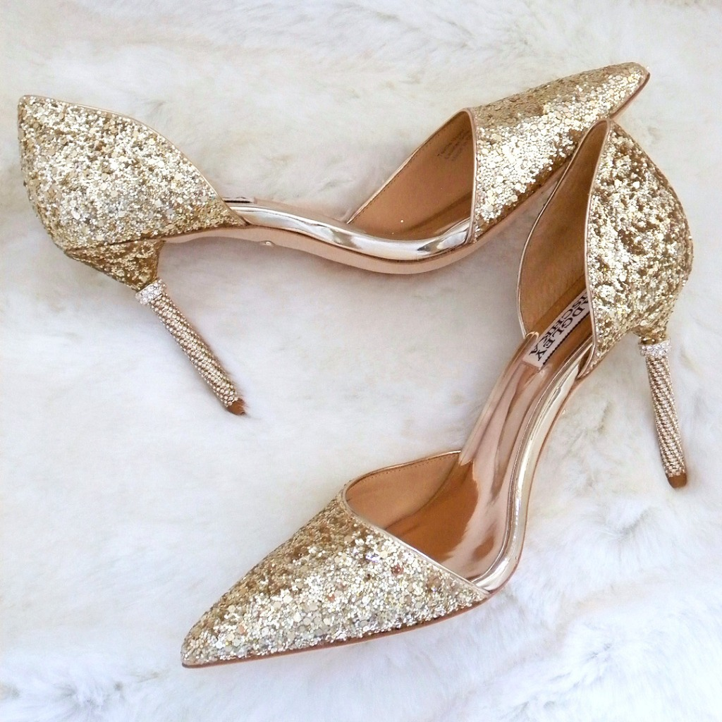 Glitter lover must have! Gold glitter covers an updated D'Orsay Pump with a rhinestone adorned heel.Super sexy cut, modern & glamorous