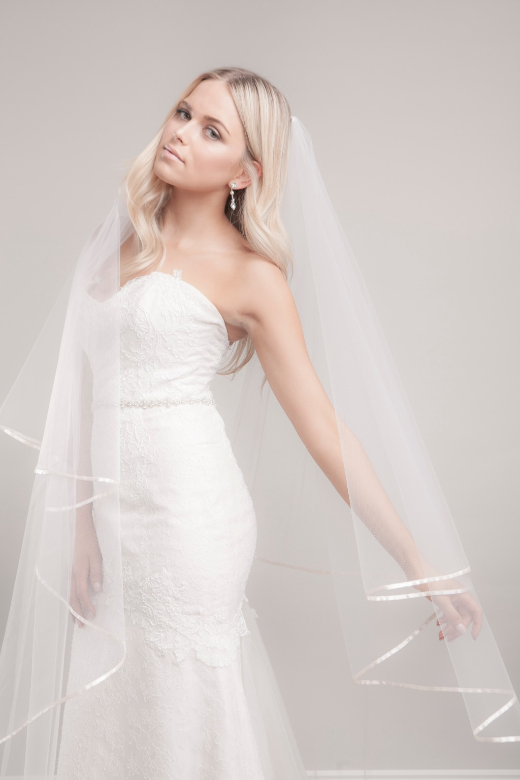 Looking for traditional oval cut wedding veil? Miranda cathedral veil is an elegant two-tier style that beautifully finished with Japanese