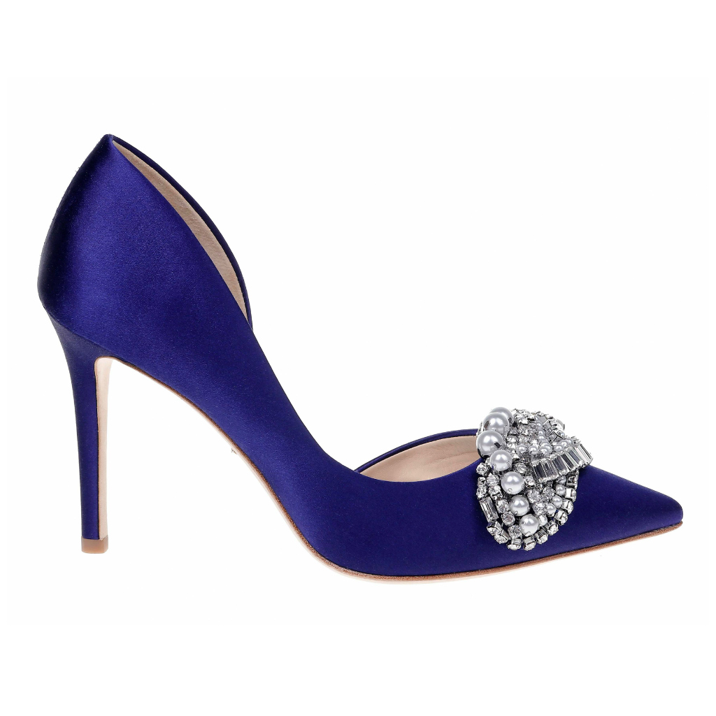 The new Sex and The City Shoe . Classic pump with a low cut side and spectacular ornatment at the toe in a fabulous blue shade.