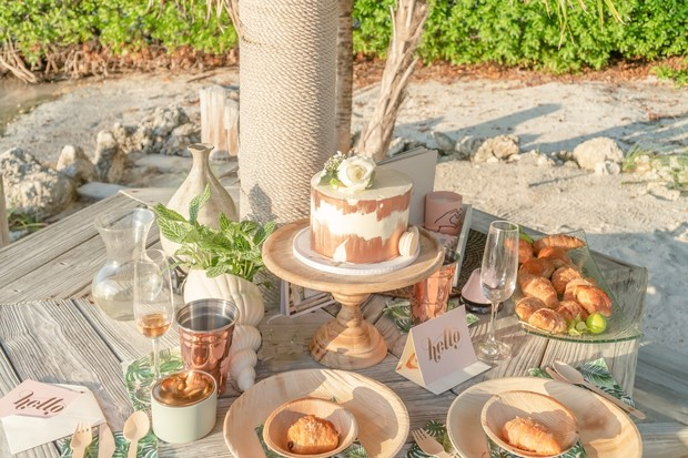 gold and white wedding breakfast at the beach