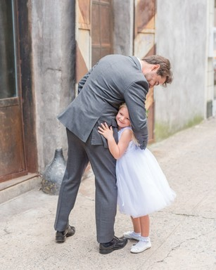 sweet groom and flower girl photo