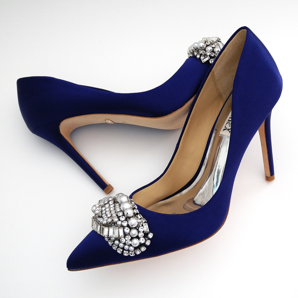 The new Sex and The City Shoe . Classic pump with a low cut side and spectacular ornat\ment at the toe in a fabulous blue shade
