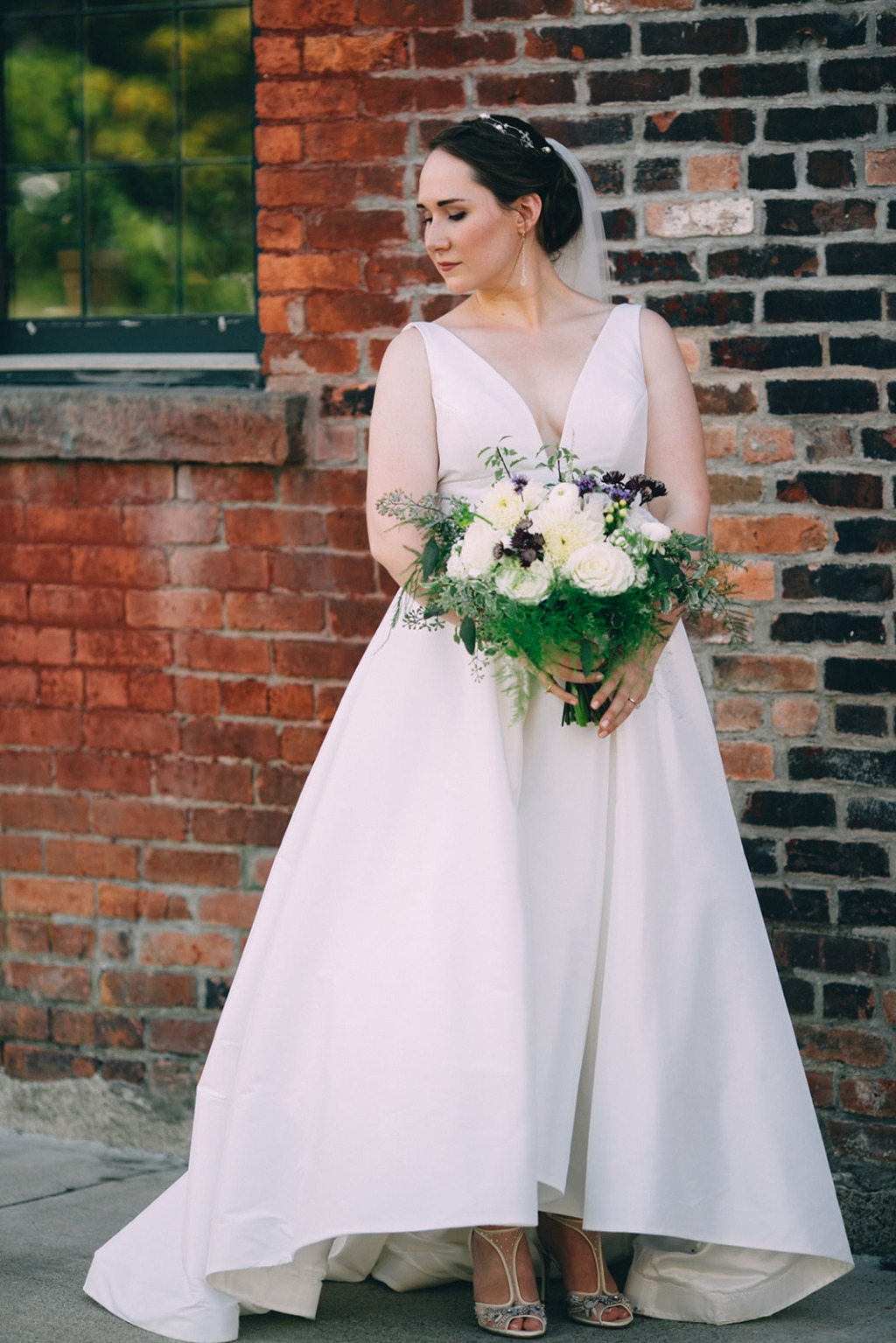 An industrial setting and rustic details set the tone for Erin and Casey's garden-meets-city wedding in upstate New York. Dress: