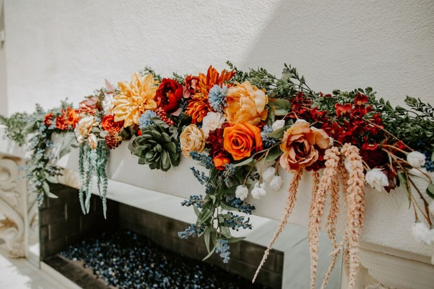 floral fireplace ceremony backdrop