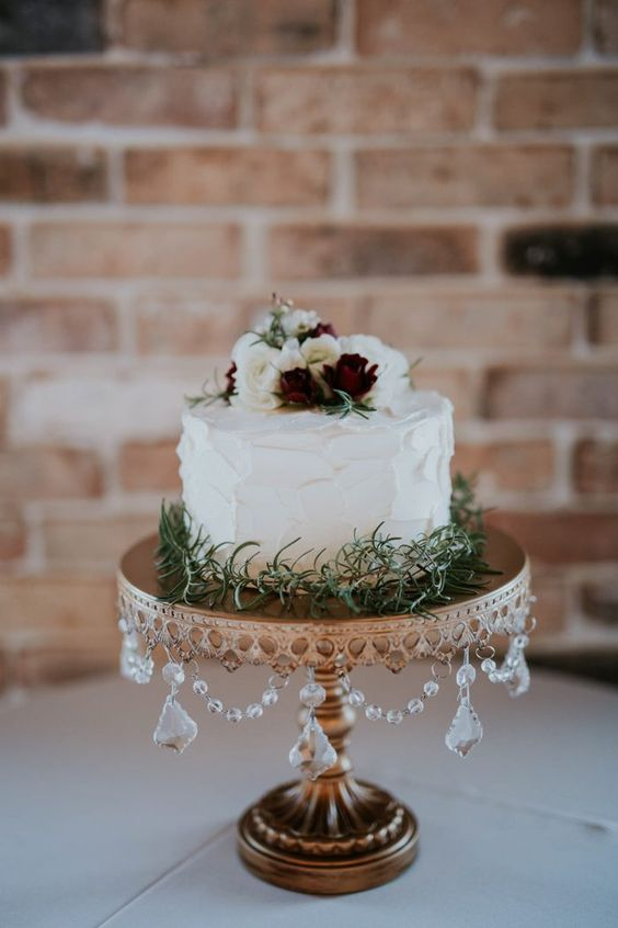 Opulent Treasures Signature Chandelier Wedding Cake Stand in Antique Gold. Photo by Emily Magers
