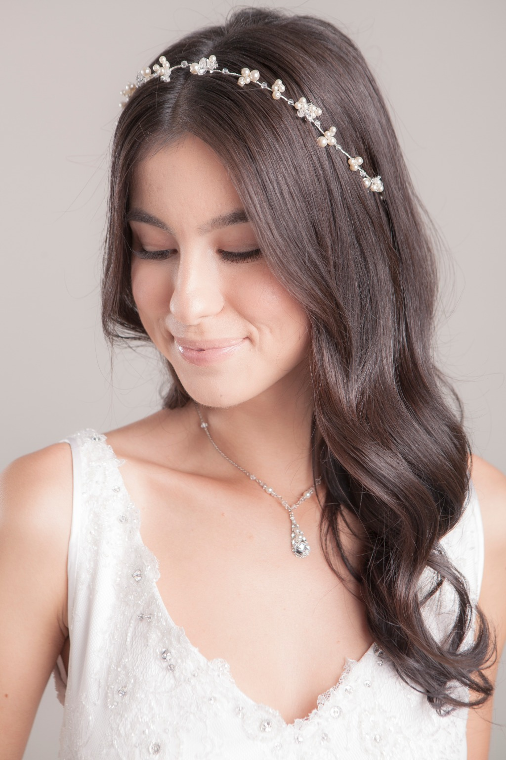 Click thru to see Swarovski pearl and crystal clusters hair vine from Laura Jayne!