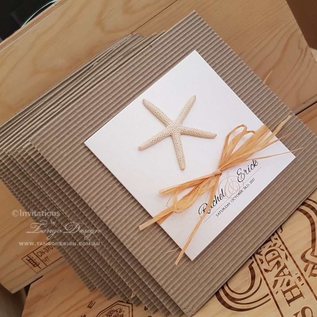 These are one of our latest beach jobs for a Mexico wedding! Corrugated board + pearlescent printed card and raffia.