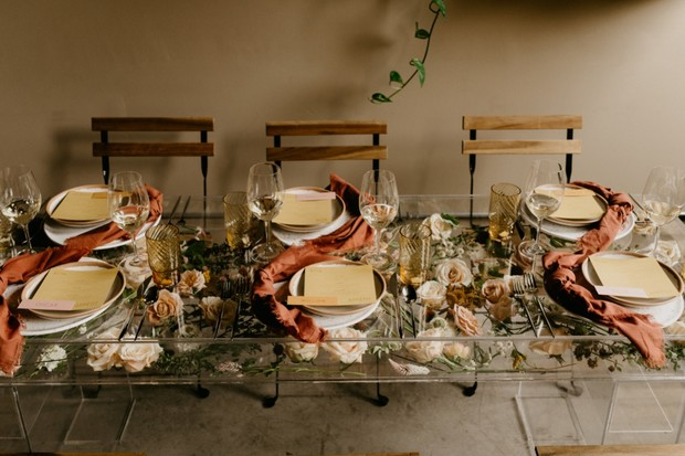 acrylic table top with floral decor wedding idea