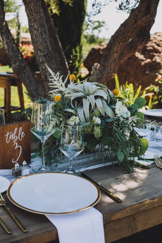 elegant white and gold place setting with rustic charm