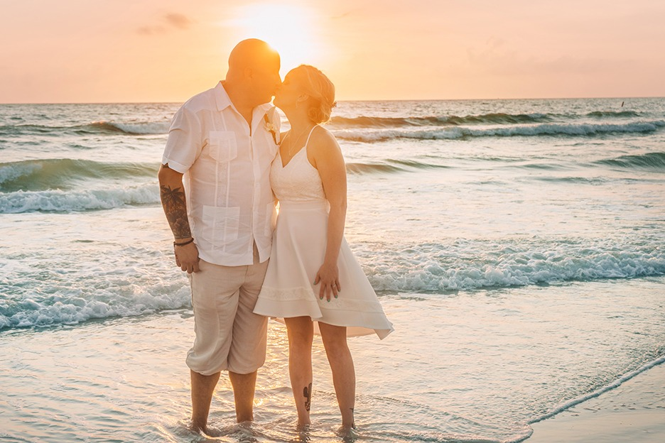 Beautiful Florida beach weddings at sunset - contact us for beach wedding specials!